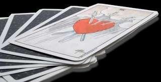 immagine che ritrae una carta su cui è raffigurato un cuore trafitto da tre spade