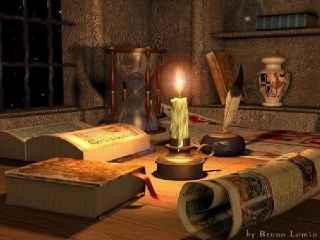 immagine che ritrae una candela accesa al centro di libri da divinazione